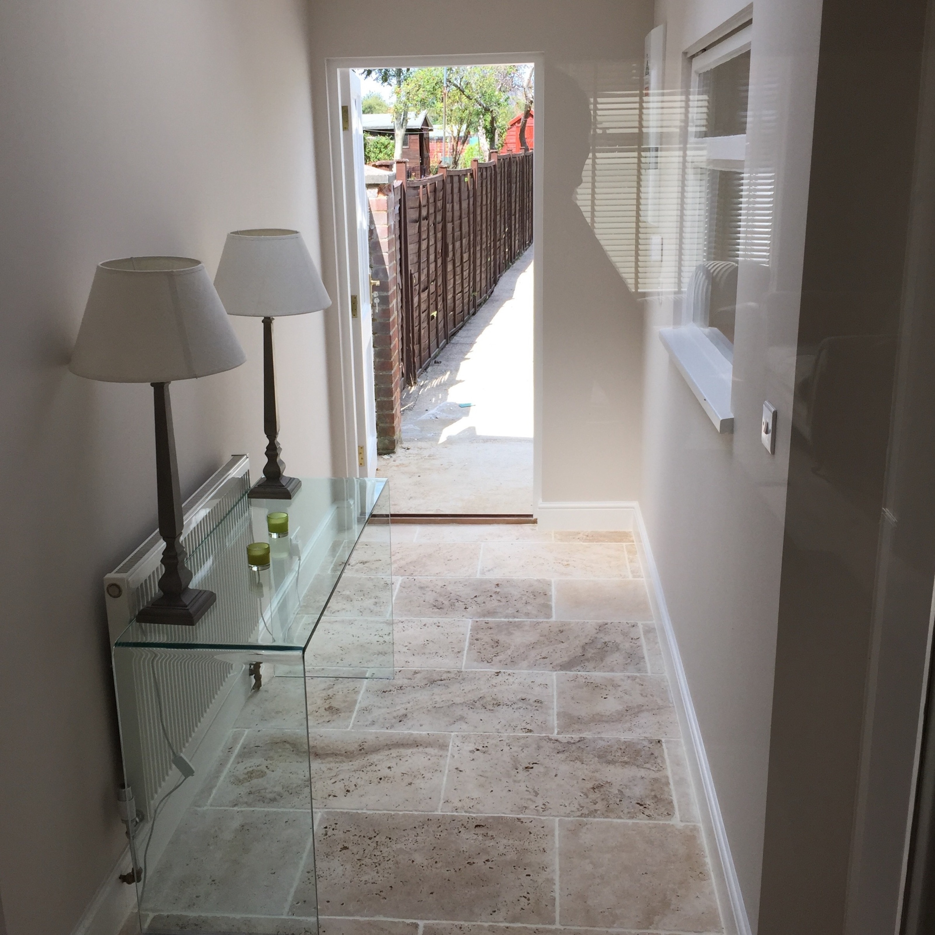 House hallway interior design with glass table