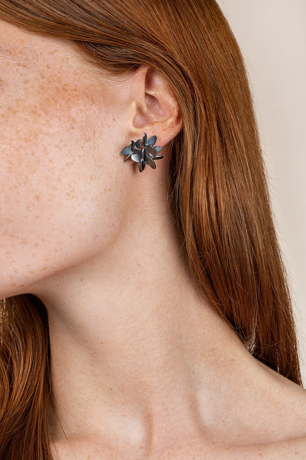 Lyng large statement silver earrings isnpired by leaves, nature and origami. Designed by Scandinavian jewelry designer Kaja Gjedebo