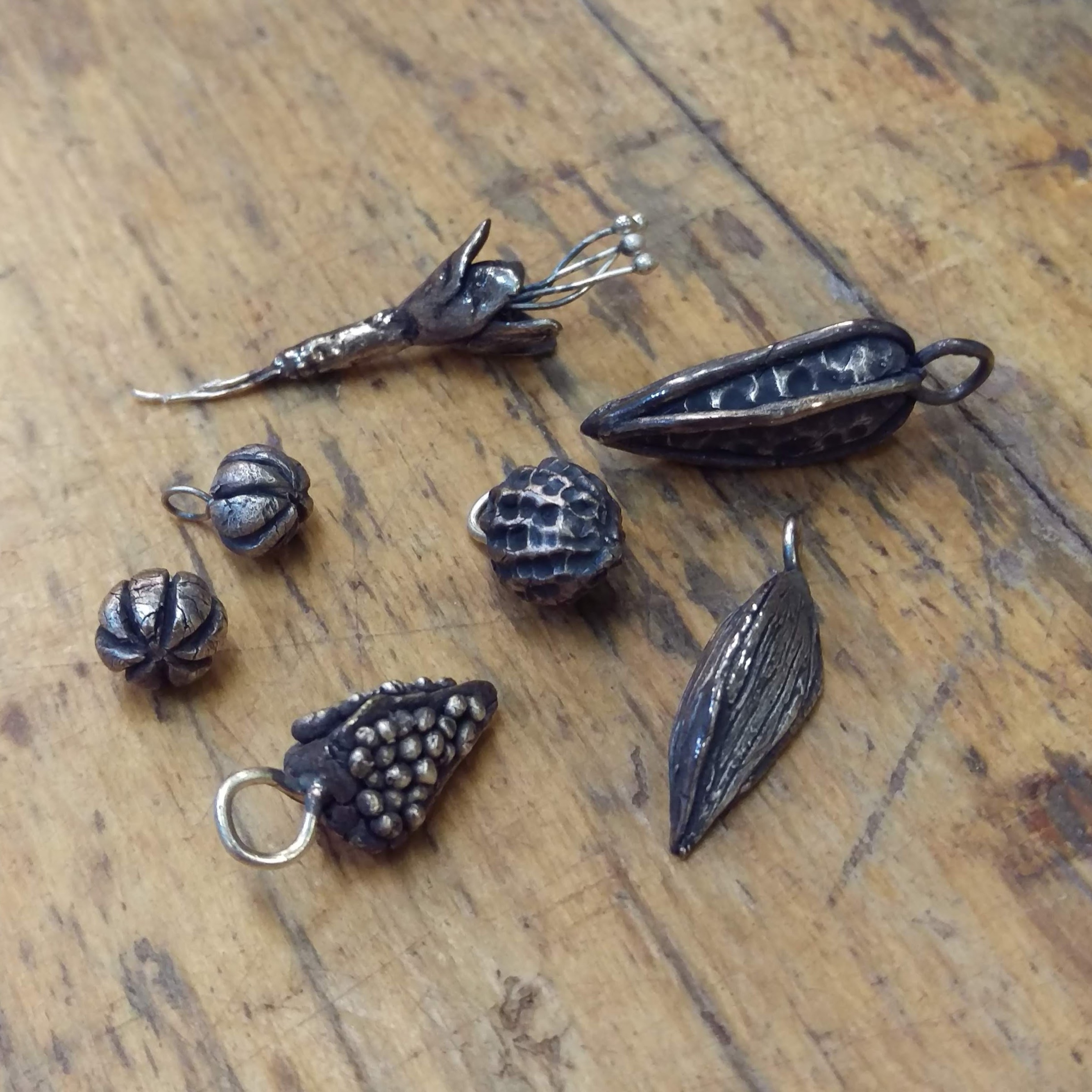 Oxidised silver pod and flower charms made during one day silver clay course