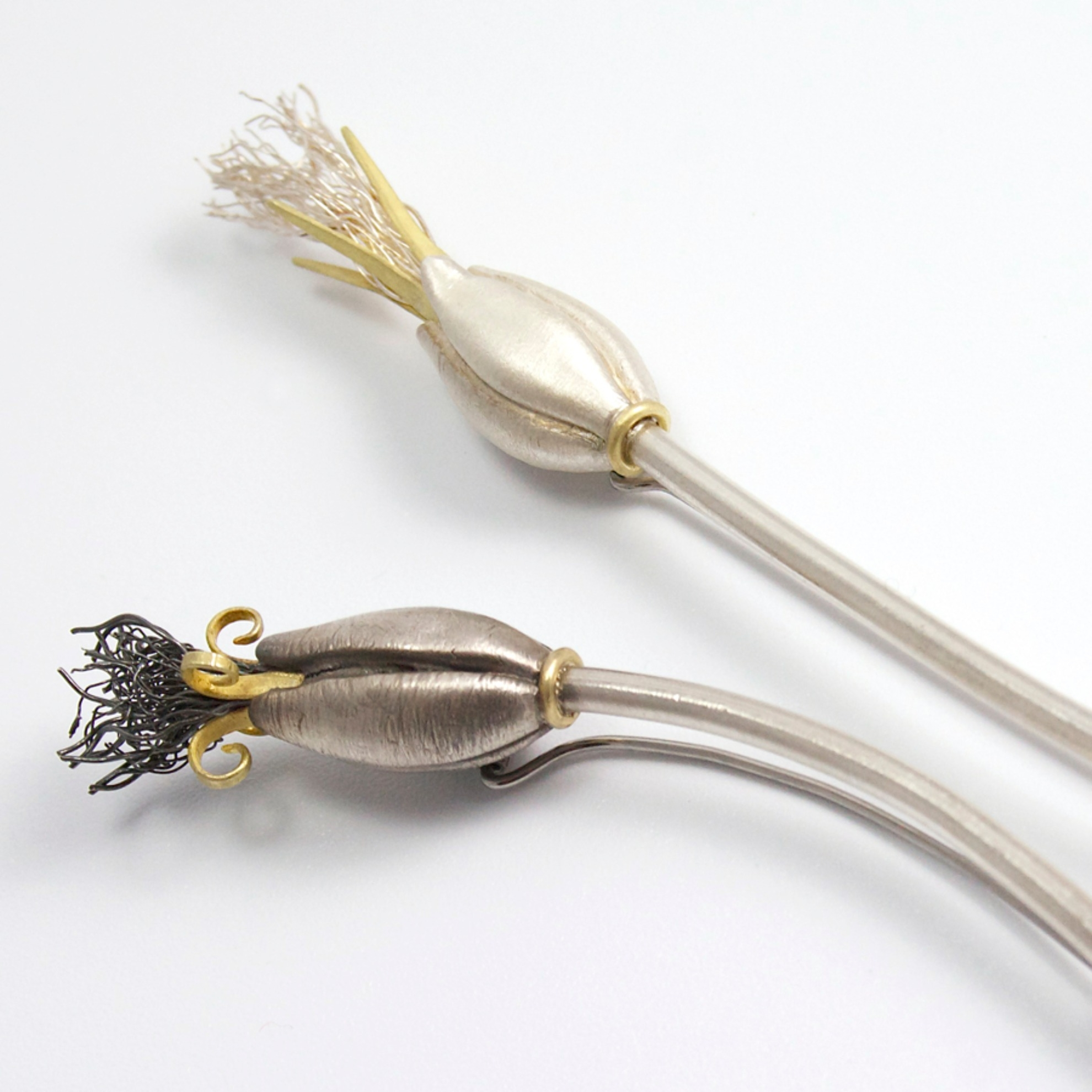 Flower pins, silver wire, silver clay and 18ct yellow gold sheet..