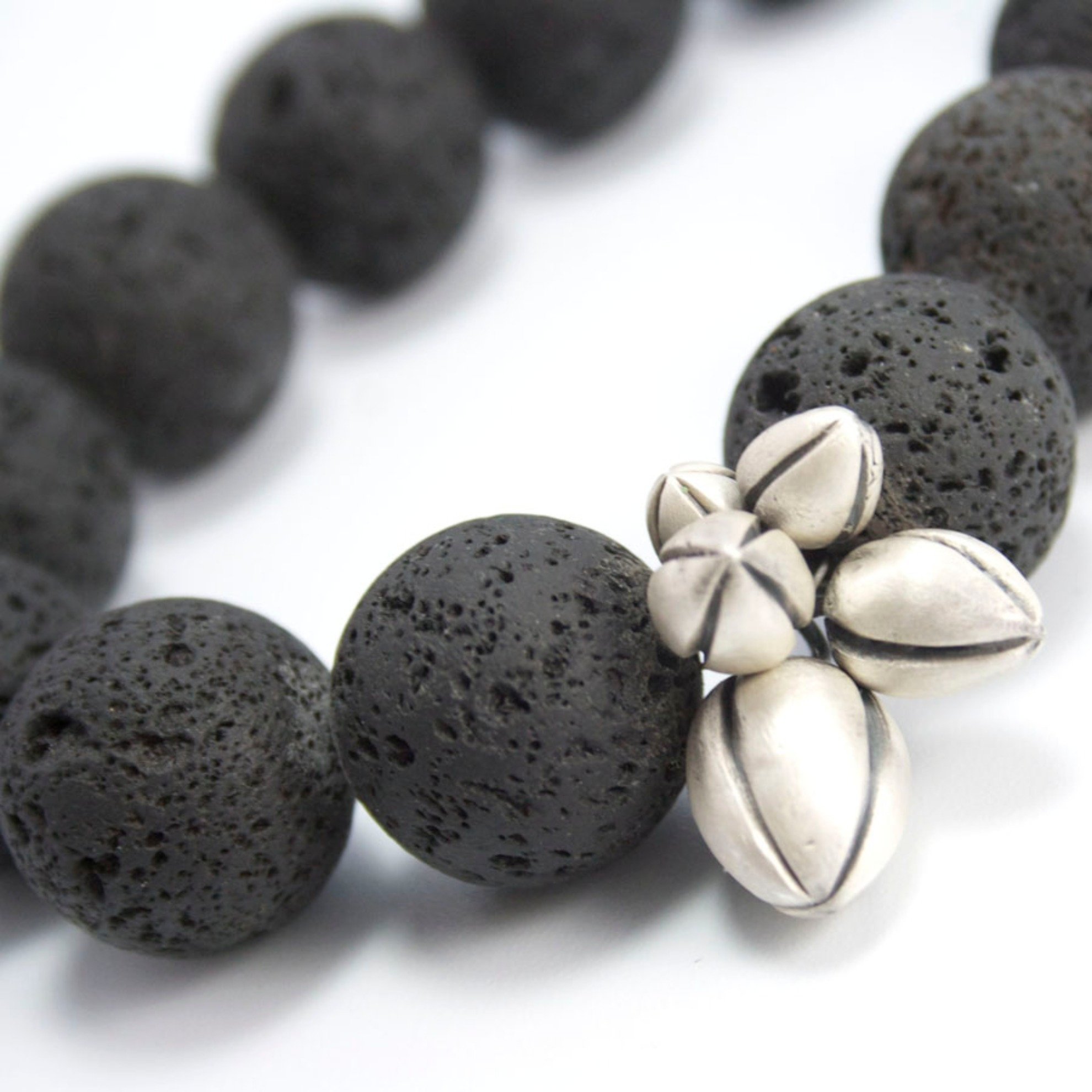 Buds Necklace, silver clay and lava.