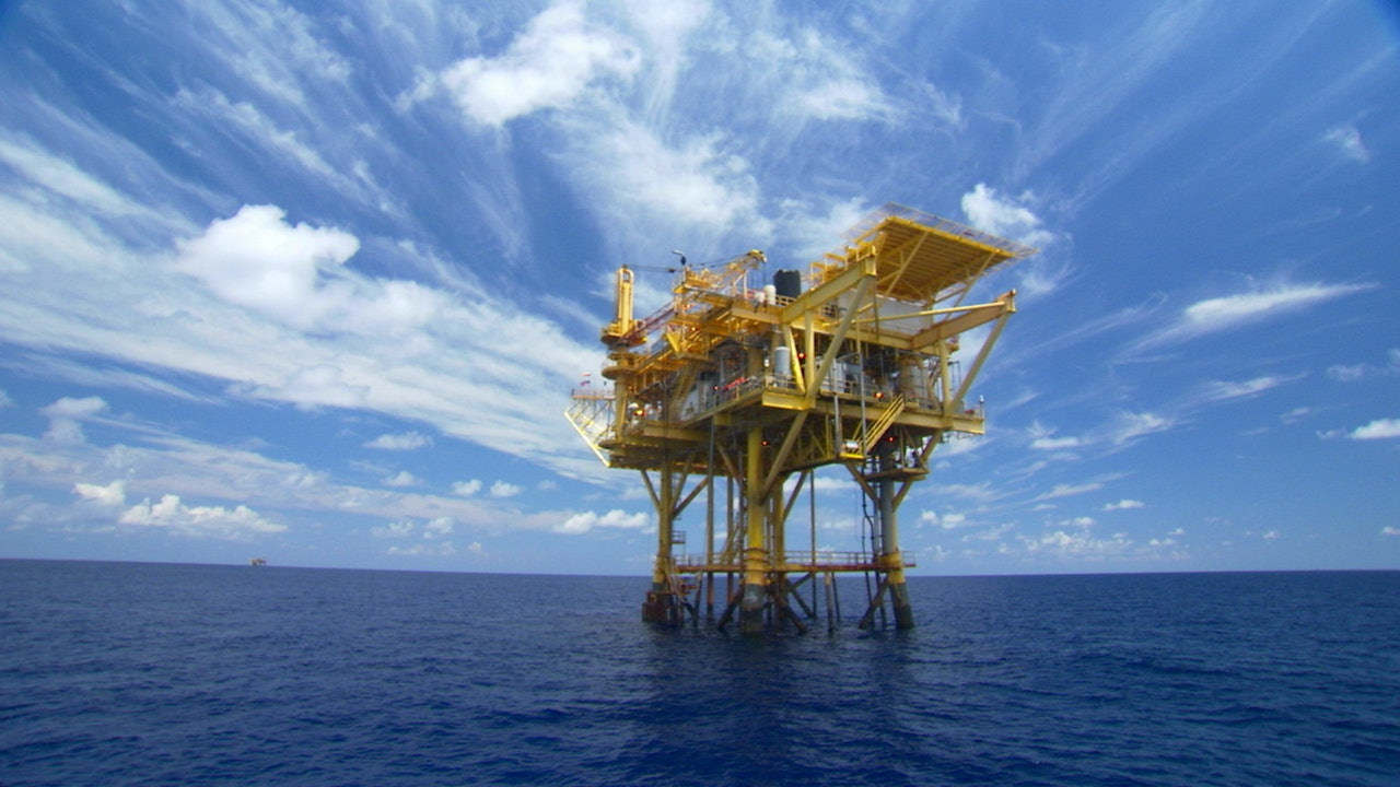 Oil rig gas platforms offshore Gulf of Mexico stock footage video