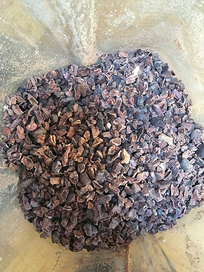 Organic raw cacao in the blender.